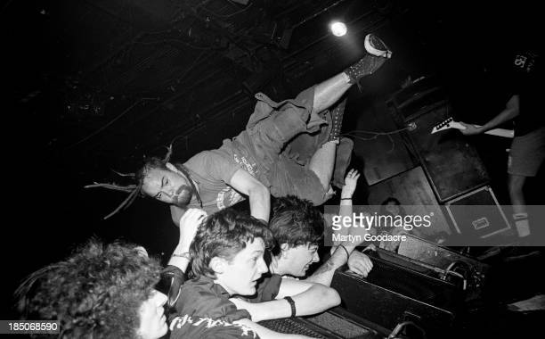 Crowd surfing as Napalm Death perform on stage at the ICA London United Kingdom 1990