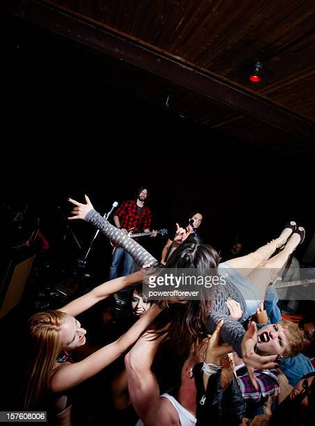 Crowd Surfing at a Rock Concert