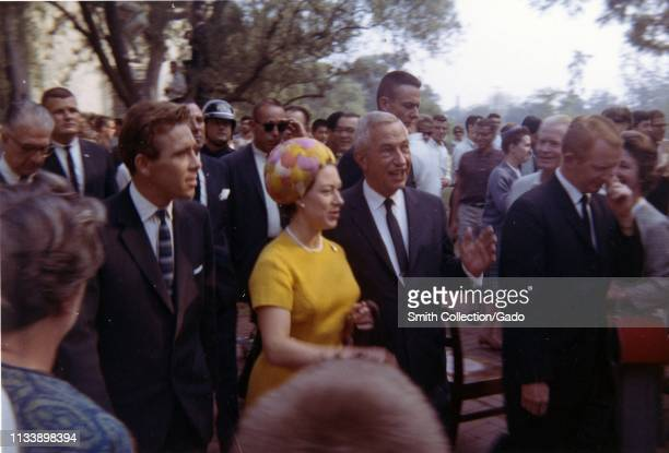A crowd surrounds Caltech President Lee Alvin DuBridge as he escorts Princess Margaret and her husband Lord Snowdon during their visit to the...