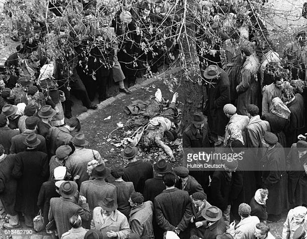 A crowd surrounds the burnt corpse of a lynched police secret agent in Hungary in 1956 As part of an attempt to introduce reforms and increase...