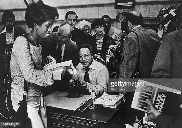 Crowd throngs around Alex Haley, author of book, Roots, at the Broadway department store book department in Fox Hills Mall. Those waiting to have...