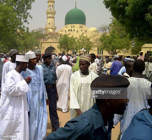 A crowd wait outside the central mosque in the northern Nigeria city of Kano on May 15 2012 to witness the mass wedding of 100 divorcees and widows...