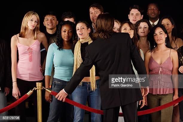 Crowd Waiting Behind Velvet Rope