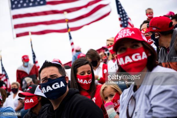 Crowd waits for the arrival of President Donald Trump at a campaign rally on September 19, 2020 in Fayetteville, North Carolina. With the election...
