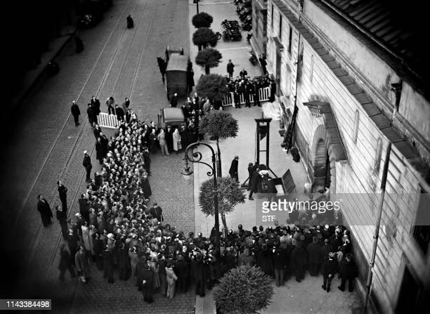 Crowd waits for the execution of Eugen Weidmann on June 17 in Versailles, outside the prison Saint-Pierre. He is found guilty of murder and sentenced...