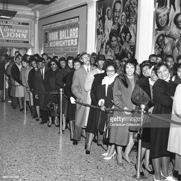 Crowd waits in line outside the Apollo Theater in circa 1959 in New York. The marquee reads Hank Ballard and the Midnighters, Little Willie John.