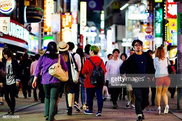 Crowd walking down the street