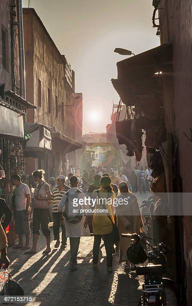 Crowd walking in street, Jamaa el Fna Square, Marrakesh, Morocco,