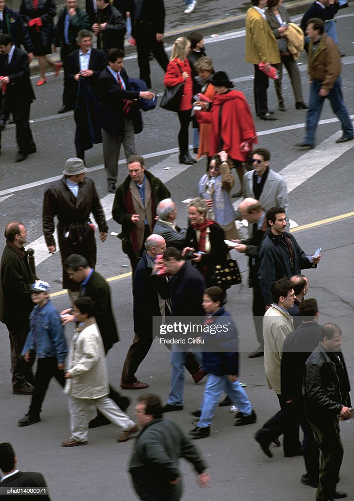 Crowd walking in street, view from above, blurred. : Stockfoto