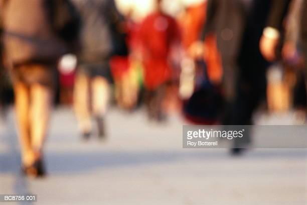 Crowd walking in urban scene, low section (defocussed)