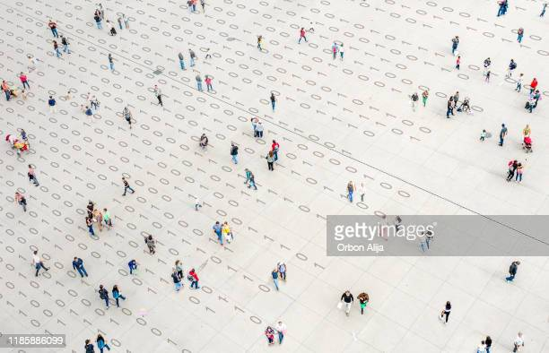 crowd walking over binary code - data privacy stock pictures, royalty-free photos & images