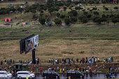 soweto south africa crowd walks alongside