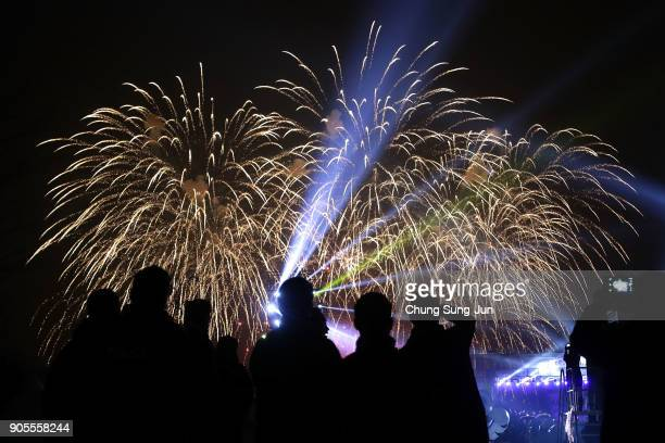 A crowd watches a fireworks display during the PyeongChang 2018 Winter Olympic Games torch relay on January 16 2018 in Seoul South Korea