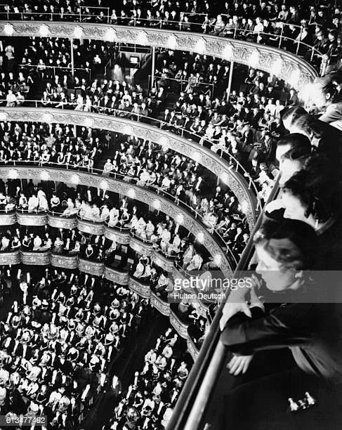 A crowd watches a performance of Verdi's Othello on opening night at the Metropolitan Opera House in New York