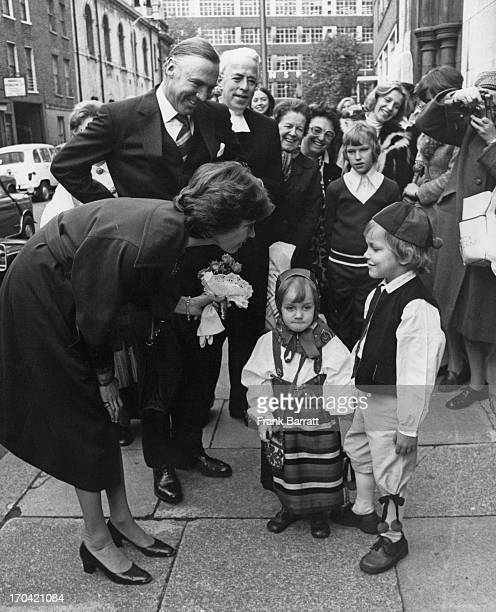 Crowd watches as Princess Margaretha of Sweden and husband John Ambler chat to six year old Mattias Revelios and three year old Sophie Persson at the...