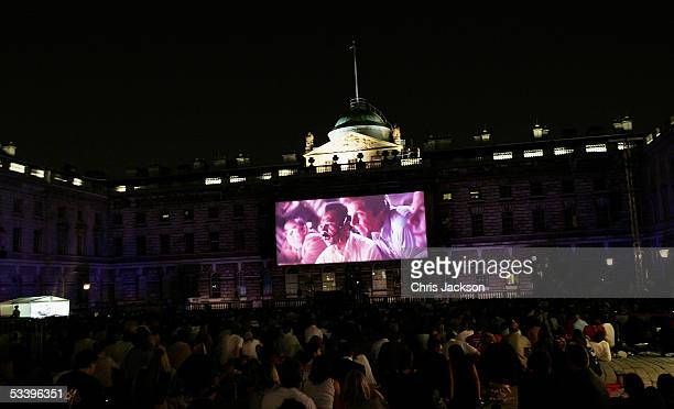 A crowd watches 'Close Encounters of the Third Kind' as FilmFour and Somerset House present their first annual movie season of outdoor screenings at...