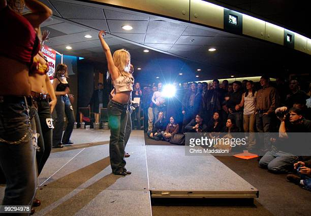 """Crowd watches contestants perform at the """"Coyote Ugly Bartender Search Finals"""" for the new Washington, DC bar location at the F Street bar in the MCI..."""