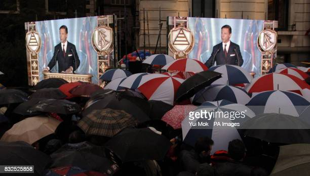 A crowd watches guest of honour David Miscavige Chairman of the Board of the Religious Technology Centre and leader of the Scientology religion...