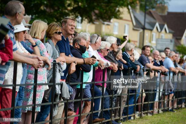 Crowd watches on as The Secret Spitfires Memorial is unveiled at the Salisbury Rugby Club on July 09, 2021 in Salisbury, England. Salisbury's newest...