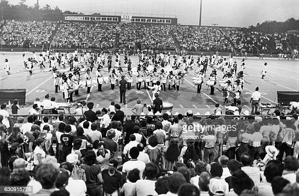 A crowd watches the 15th annual Catholic Youth Organization Nationals drum and bugle corps competition at Boston College's Alumni Stadium in Chestnut...