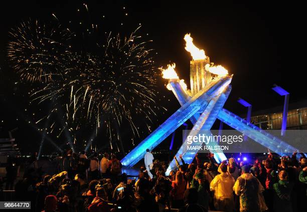 Crowd watches the fireworks after ice hockey legend Wayne Gretzky lit the external Olympic Cauldron in Coal Harbour, during the 2010 Winter Olympic...