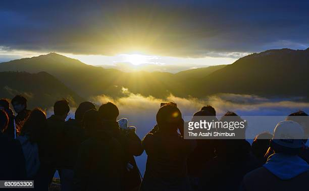A crowd watches the first sunrise of the year from Takeda Castle ruins on January 1 2017 in Asago Hyogo Japan