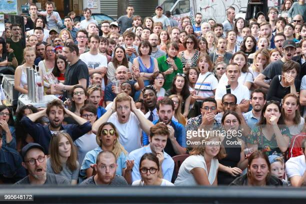 Crowd watches the France v Belgium semi-final World Cup match outside a local bar in the 20th arrondissement, on July 10, 2018 in Paris, France.