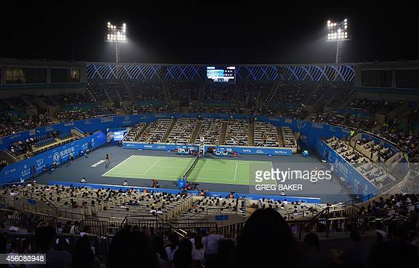 A crowd watches the quarterfinal match between Caroline Wozniacki of Denmark and Switzerland's Timea Bacsinszky at the Wuhan Open tennis tournament...