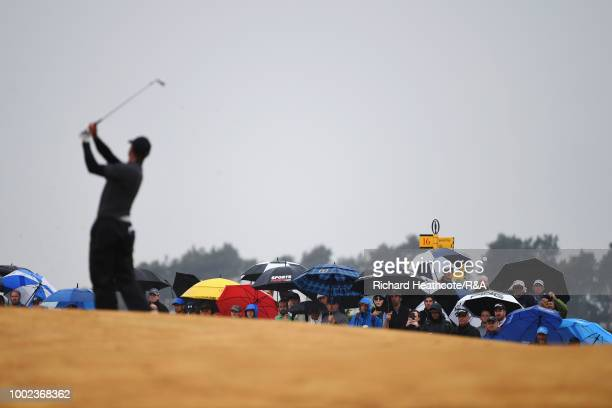 Crowd watches Tiger Woods of the United States play his second shot on the 1st hole during round two of the Open Championship at Carnoustie Golf Club...