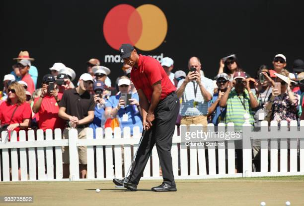 A crowd watches Tiger Woods warm up before the Arnold Palmer Invitational on Sunday March 18 2018 at Bay Hill Club Lodge in Orlando Fla