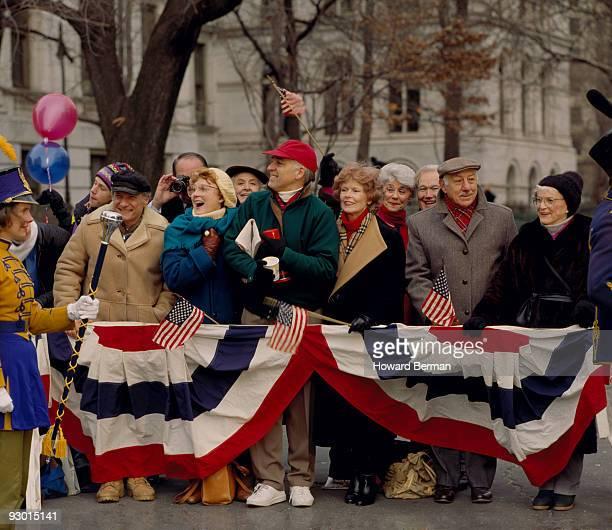 crowd watching a parade. - cabalgata fotografías e imágenes de stock