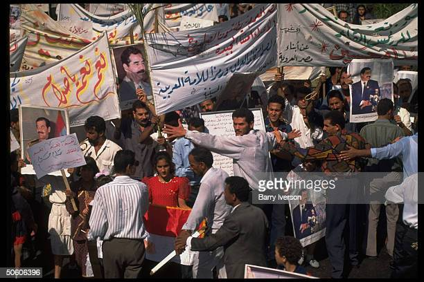 Crowd waving pics of Saddam Hussein at campaign rally for Pres single cand in 2 daysaway yes or no referendum election