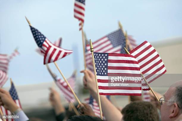 crowd waving stars and stripes flags - citizenship stock pictures, royalty-free photos & images