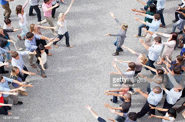 crowd with arms outstretched - welcoming stock photos and pictures