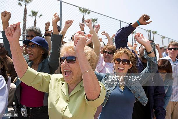crowd with arms raised - political rally stock pictures, royalty-free photos & images