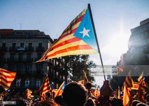 crowd with flags against clear sky - catalonia stock pictures, royalty-free photos & images