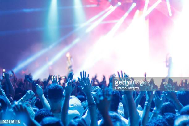 crowd with hands up at concert - concert stock pictures, royalty-free photos & images