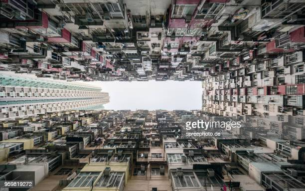 crowded apartment buildings in hong kong - kowloon peninsula stock pictures, royalty-free photos & images