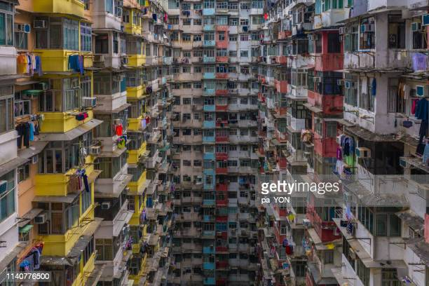 crowded apartment residential buildings in hong kong - finance and economy stock pictures, royalty-free photos & images