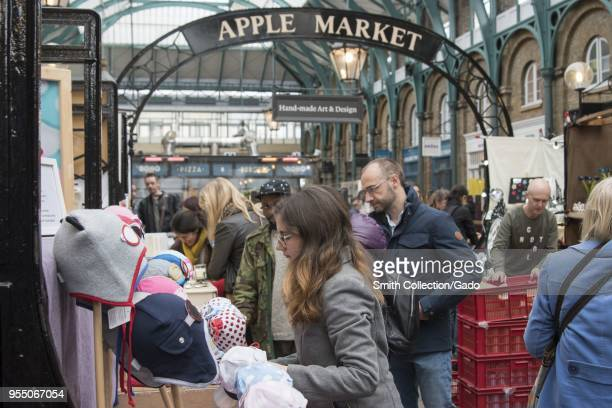 Crowded Apple Market in the New Covent Garden Market Nine Elms London United Kingdom October 29 2017