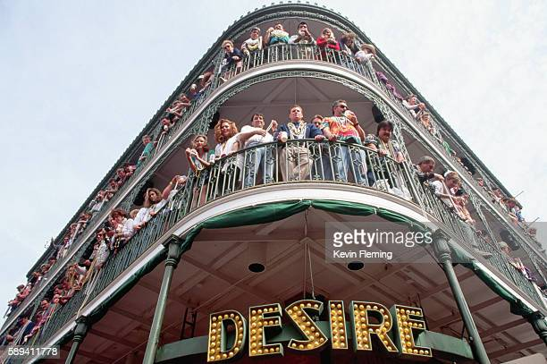 crowded balconies during mardi gras - gras foto e immagini stock