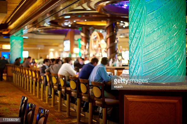 crowded bar in vegas casino - casino stock pictures, royalty-free photos & images