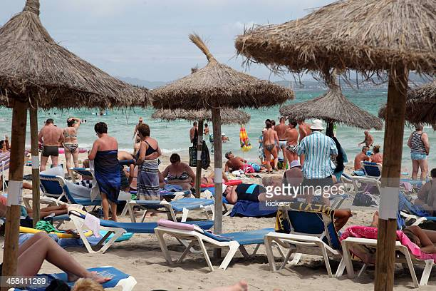 crowded beach at can picafort, spain - skimpy bathing suits stock pictures, royalty-free photos & images