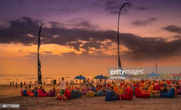 Crowded beach at dusk in Bali, Indonesia