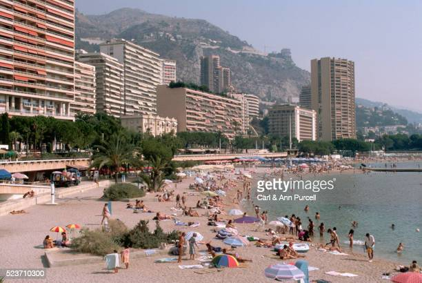 crowded beach at monte carlo - monte carlo stock pictures, royalty-free photos & images