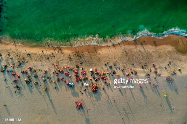 crowded beach from above - angola bildbanksfoton och bilder