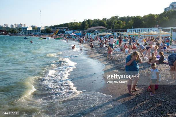 crowded beach in odessa - odessa ukraine stock photos and pictures