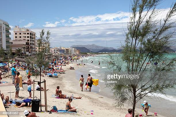 crowded beach on balearic islands - skimpy bathing suits stock pictures, royalty-free photos & images