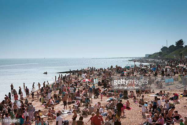 crowded beach - newpremiumuk stock pictures, royalty-free photos & images