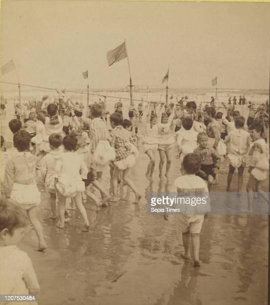 Crowded beach scene, John S. Johnston Albumen silver print.